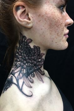 Polly Ellens shows off her neck chrysanthemum tattoo by Claudia De Sabe! Book with Claudia on the Tattoodo App or find an artist near you! - #necktattoo #flowertattoo #blackandgreytattoo #japanesetattoo #chrysanthemumtattoo #pollyellens #tattoomodel #tattooinspo #tattooideas