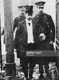 British murderer Frederick Henry Seddon accompanied by two police officers, circa 1912. Seddon poisoned his lodger, Eliza Barrow, in September 1911. He and his wife were later charged with Barrow's murder. She was acquitted while Seddon was hanged at Pentonville Prison on 18th April 1912.