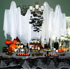Ghosts make a great backdrop. Halloween Dessert Table #halloween