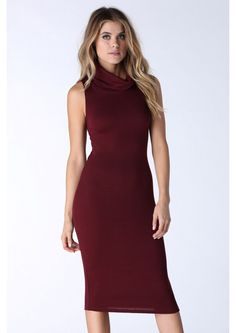 What's The Scoop Midi Dress in Burgundy | A charming midi dress featuring a slouchy turtleneck. This dress is sleevess which balanes out the neckline. Has a cross over cut out detail on the back. Stretchy materials hugs your body accentuating your curves. Throw on a pair of pumps and accessorize and you're ready to go!