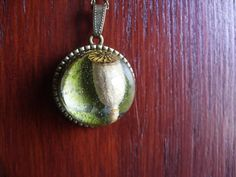 Necklace with real poppy pod in resin by zusnA on Etsy