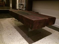 Sanded Smooth Railway Sleeper Coffee Table, 'floating' on toughened glass legs.