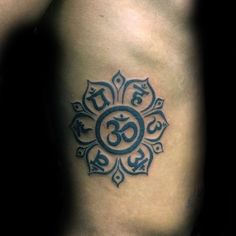 Male With Om Flower Tattoo On Rib Cage Side Of Body