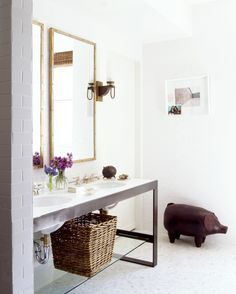 White subway tile with an iron vanity