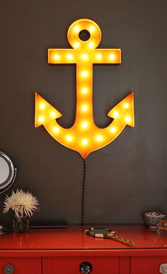 #VintageMarqueeLights Adorable Rusty anchor light.  Great wall art for a  coastal and/or nautical themed room!   www.vintagemarqueelights.com http://blog.vintagemarqueelights.com
