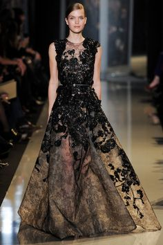 Elie Saab Spring 2013 Couture gown boasted a glittering, lace embroidered bodice with cap sleeves and a lace-print skirt.