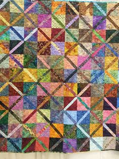 Scrappy batik quilt from Women of the West quilt show 2017.