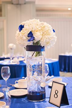 Royal Blue + Gold Wedidng Centrepiece  For all the details, check out http://www.weddinggirl.ca/blog/2013/03/18/royal-blue-gold-wedding-port-credit-mississauga/