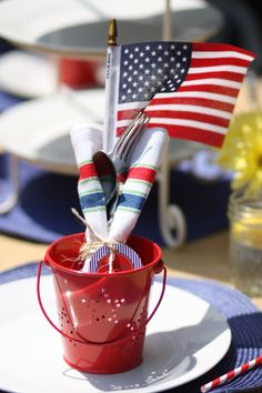 American flag, silverware and striped napkin wrapped with twine
