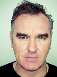 Morrissey, he would probably exasperate me, but his conversation would likely be fascinating.