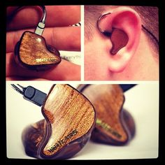 Custom built and fit in-ear monitors by '64 Audio. An amber colored shell with Hawaiian Koa wood inlays.