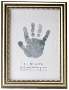 """[""""This piece of wall art makes for a great way to remember your baby's dedication day. Included is child-safe silver stamp to put their handprint on the piece. At the bottom the sentiment below the title """"Dedicated"""" reads: """"I will know his touch in my hands & love in my heart...""""<br><br><b>Product Details:</b><br>Size: 5""""(W) x 7""""(H)<br>Wooden Frame<br>""""] $18.99"""
