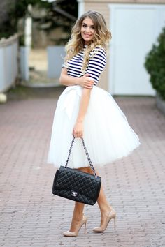 Love the combination of stripes and the skirt.