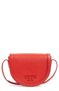 Crushing on this Tory Burch saddle bag in a pop of color. This chic handbag…
