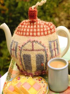 Cottage Tea Cozy knitting pattern published in Tea Cozies 3 -  £9.99 on Laughing Hens at http://www.laughinghens.com/knitting-pattern-page.asp?patternpageid=23610
