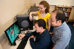 Dr. Henry Wan works with two of his students on his AntigenMap program in support of influenza vaccine research.