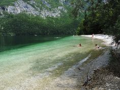 Lake Bohinj, Slovenia. Slovenia has only one national park, Triglav. But that's a real treasure! A mountain paradise with snowcapped peaks and magically green lakes, creeks and waterfalls. Its most easily accessible areas are around Lake Bled and Lake Bohinj, two big, famous and pretty lakes.