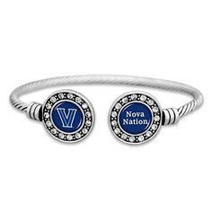 This cuff bracelet is the perfect accessory to show off your Gators pride! - Silver Tone Collegiate Cuff Bracelet - Double Circle with Logo and Spirit Chant in Team Colors - Lead, Nickel, and Cadmium Safe and Protected from Tarnishing Oklahoma Sooners, Michigan Wolverines, Ohio State Buckeyes, Auburn Tigers, Villanova Wildcats, Go Big Blue, Texas Tech Red Raiders, Circle Logos, Silver Accessories
