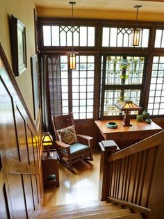 The stair hall and windows are as built. Three Prairie-style wood lamps in the house are attributed to the Peterson Art Furniture Company in Minnesota.