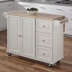 Featuring a wine rack, shelf, and towel bar, this essential wood cart brings ample storage space to your kitchen or dining room.