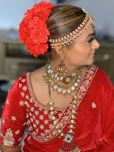 Stunning and Elegant monochrome bridal look. Right from hairstyle, jewellery and lehenga every piece is royal red.    #Indianweddings #shaadisaga #indianbridalhairstyles #hairstyleswithflowers #intimatewedding #realflowers #uniquecolourlehenga #babybreaths #lowbun  #exoticflowerhairstyle #carnations Bridal Makeup Looks, Bridal Looks, Indian Bridal Hairstyles, Wedding Hairstyles, Wedding Looks, Wedding Bride, Red Carnation, Red Photography, Red Color