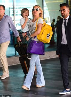 Jet-set style winner: Kate Hudson looked super-cool in her stylish outfit as she arrived a...