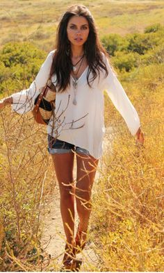 I love floaty, simple summer clothes.  This simple white shirt and shorts combination would be perfect.
