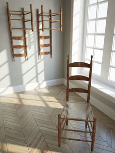 Shaker style chairs -- despite the severe simplicity, they also contain a remarkable pivot to allow sitters to lean back on two legs. They were designed to be so beautiful to attract an angel to come sit.