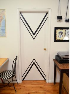 If you like the duct tape idea, you'll love this stylish door by Stacie from Stars for Street Lights. Some quick measuring, a steady hand and a bit of electrical tape totally transformed these contractor-grade doors. The result is nothing short of fabulous!