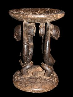 "Hemba Stool- Exceptional sculptural stools were reserved for and used by chiefs and kings. The seat is supported by both male & female ancestral figures. Stools are still used today as seats of power and prestige.   Provenance: Ex Private Collection. Collected about 50 years ago by a Belgian living in the D.R. Congo.   18"" high, 13"" in diameter."