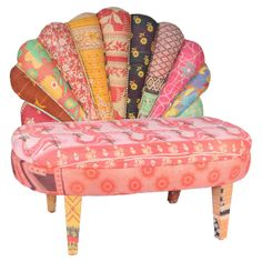 Bring a touch of bohemian style to your decor with this peacock-style settee, crafted from mango wood and showcasing vintage kantha cloth upholstery.