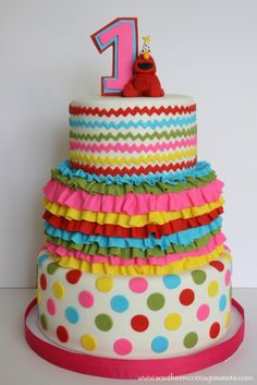 - I made this for a clients little girls first Birthday. It was to match the invites she purchased from the site Hostess With The Mostest. I was also inspired by the cake they had done for the Rainbow Elmos World Party.