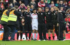 Suarez, Torres, Garcia, Alonso, Gerrard,  Kuyt and  Arbeloa (left to right) gather for a photo together after the full-time whistle