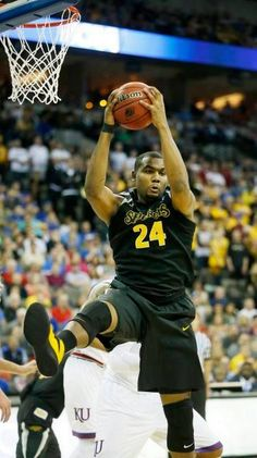 Wichita State forward Shaquille Morris grabs a rebound against Kansas in the NCAA Tournament at CenturyLink Center in Omaha.
