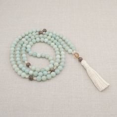 This Amazonite Garnet Mala is handmade with loving care and peaceful intentions. Mala beads for meditation and prayer by Golden Lotus Mala.