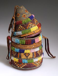 Africa | Basket with lid from North Africa; possibly Egypt | Plant fiber, glass beads, hide and pigment | ca. 1924