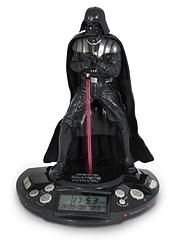"Wake up to the power of the dark side with this Star Wars Darth Vader Alarm Clock.   There's nothing like waking up to the Lord of the Sith first thing in the morning and starting your day out in a far-out way.  It will wake you with Darth Vader sound effects, plus Vader's lightsaber and base light up in red. This clock displays the time, date, radio station, and alarm information. It comes with the wall adapter or you can use 3x ""AA"" batteries, which are also included.  This clock measures…"