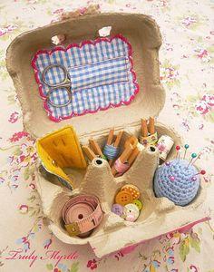 Egg carton sewing kit.