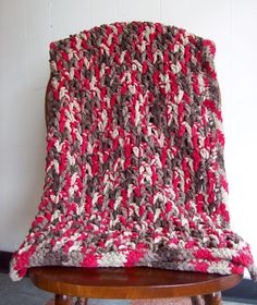 Crocheted with Bernat Blanket yarn using pattern suggested by Bernat. It's V-stitch for the body and a border of 3 rows of single crochet.