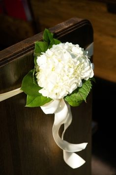 ceremony pew decor - wrap ribbon/bow around pew end with simple flower