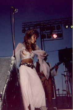 fleetwood-mac-live:  Another amazing shot of Stevie Nicks from 1975 - Early Fleetwood Mac - in white! John's just behind her.Photo by Don Ed...