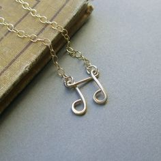 gold music note necklace