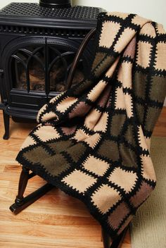Hearthside blanket made of weave-it squares done on a Schact Zoom Loom. Connected with double crochet.