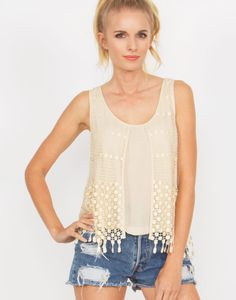 Lightweight cream tank with loose crochet panels on the front and back.