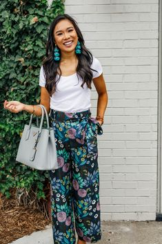 be698dade050 floral dress. Blogger Hoang-Kim styles a pair of silk wide-leg pants with  teal feather