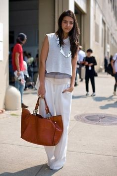 flowy silhouette: wide pants, chiffon to, light grey tank top. Via Know your rights