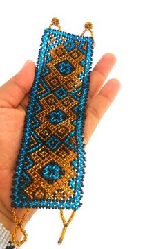 Dorado Bracelet by elizabethpalmer on Etsy , Huichol/Mexican Peyote Visions  netting , could be macrame or peyote, too. Zulu Love letter