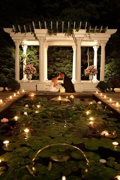 A romantic candlelit pool creates the perfect romantic moment at this Ceresville Mansion wedding. {Ceresville Mansion}