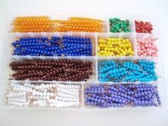 The Montessory Decanomial Box contains 55 sets of colored bead stairs 1-10. Make don't buy.