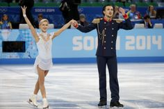 epa04070155 Tatiana Volosozhar and Maxim Trankov of Russia react after the Pairs Short Program of the Figure Skating event at Iceberg Palace...